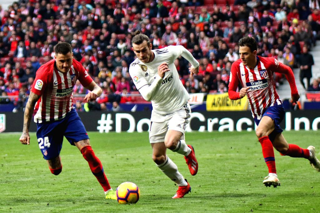 MADRID, Feb. 10, 2019 - Real Madrid's Gareth Bale (C) dribbles during a Spanish league match between Atletico Madrid and Real Madrid in Madrid, Spain, on Feb. 9, 2019. Atletico Madrid lose 1-3.