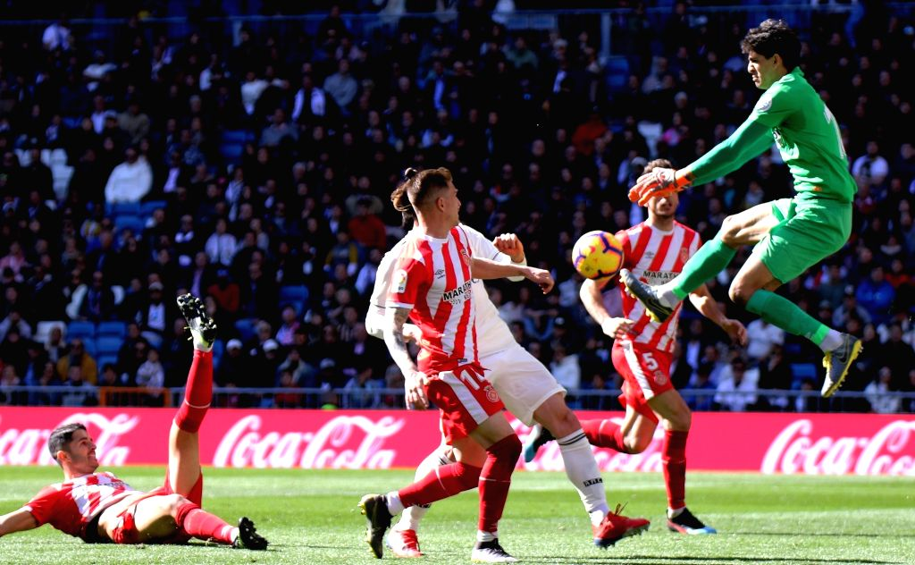 MADRID, Feb. 18, 2019 - Girona's goalkeeper Yassine Bounou (1st R) saves the ball during a Spanish league match between Real Madrid and Girona in Madrid, Spain, on Feb. 17, 2019. Real Madrid lost 1-2.