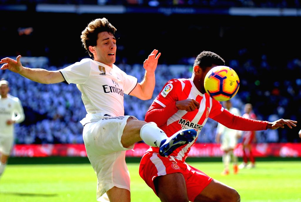 MADRID, Feb. 18, 2019 - Real Madrid's Alvaro Odriozola (L) competes with Girona's Douglus Luiz during a Spanish league match between Real Madrid and Girona in Madrid, Spain, on Feb. 17, 2019. Real ...