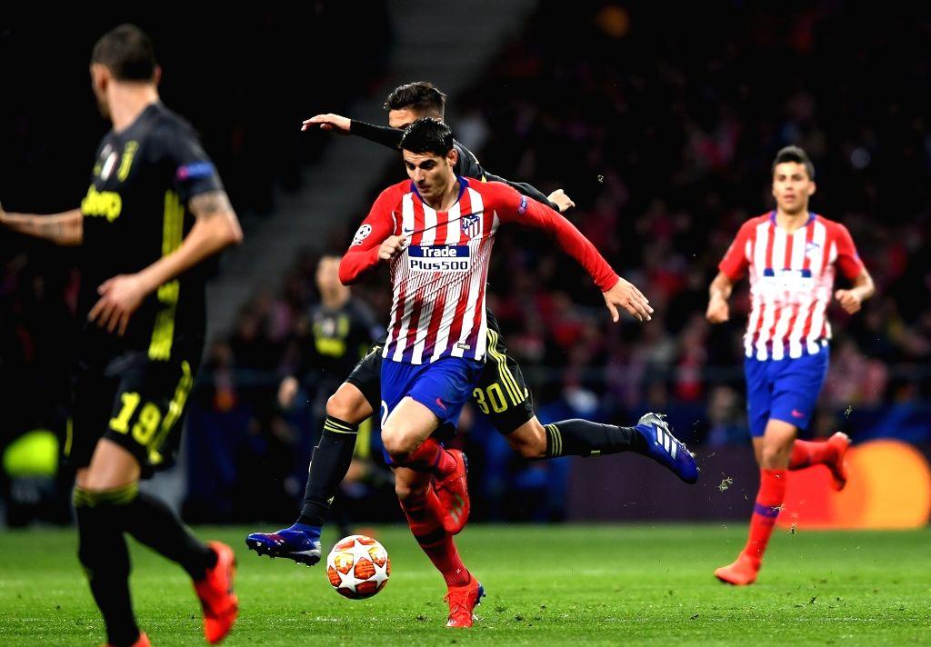 MADRID, Feb. 21, 2019 - Atletico de Madrid's Alvaro Morata (C) competes during the UEFA Champions League match between Spanish team Atletico de Madrid and Italian team Juventus in Madrid, Spain, Feb. ...