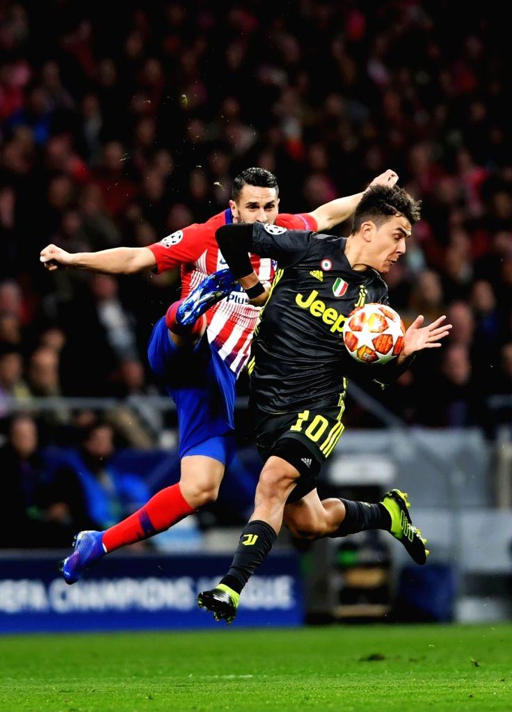 MADRID, Feb. 21, 2019 - Atletico de Madrid's Koke Resurreccion (L) and Juventus' Paulo Dybala compete during the UEFA Champions League match between Spanish team Atletico de Madrid and Italian team ...