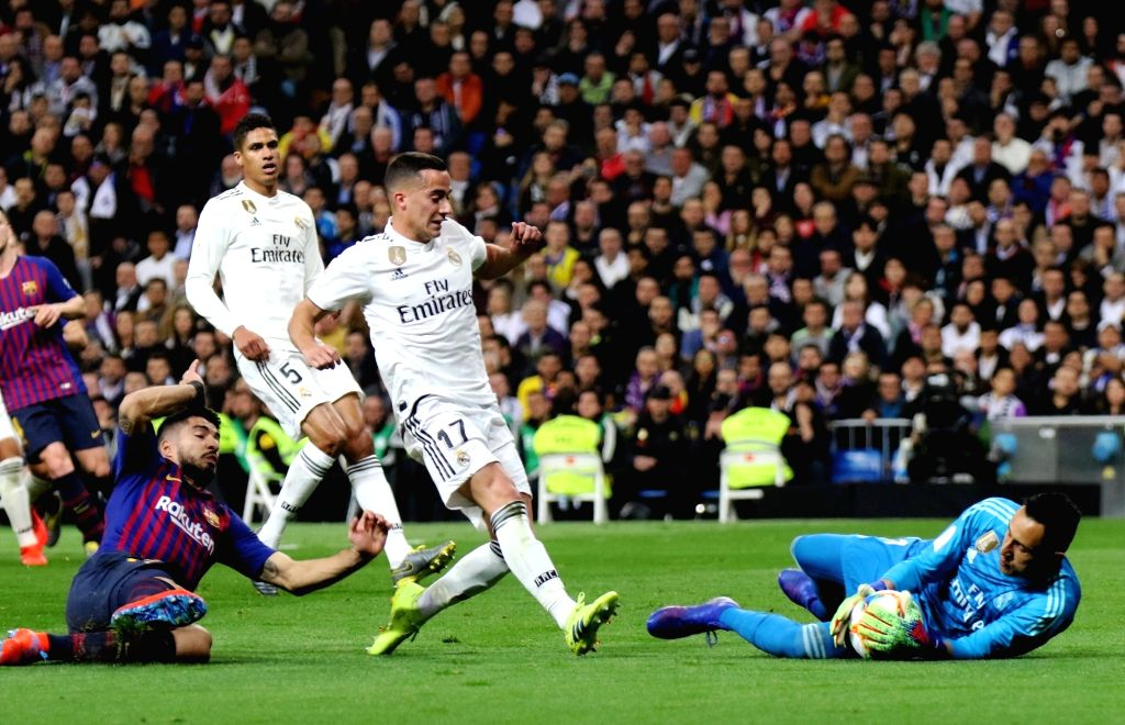 MADRID, Feb. 28, 2019 - Real Madrid's goalkeeper Keylor Navas (1st R) makes a save during the Spanish King's Cup semifinal second leg soccer match between Real Madrid and Barcelona in Madrid, Spain ...