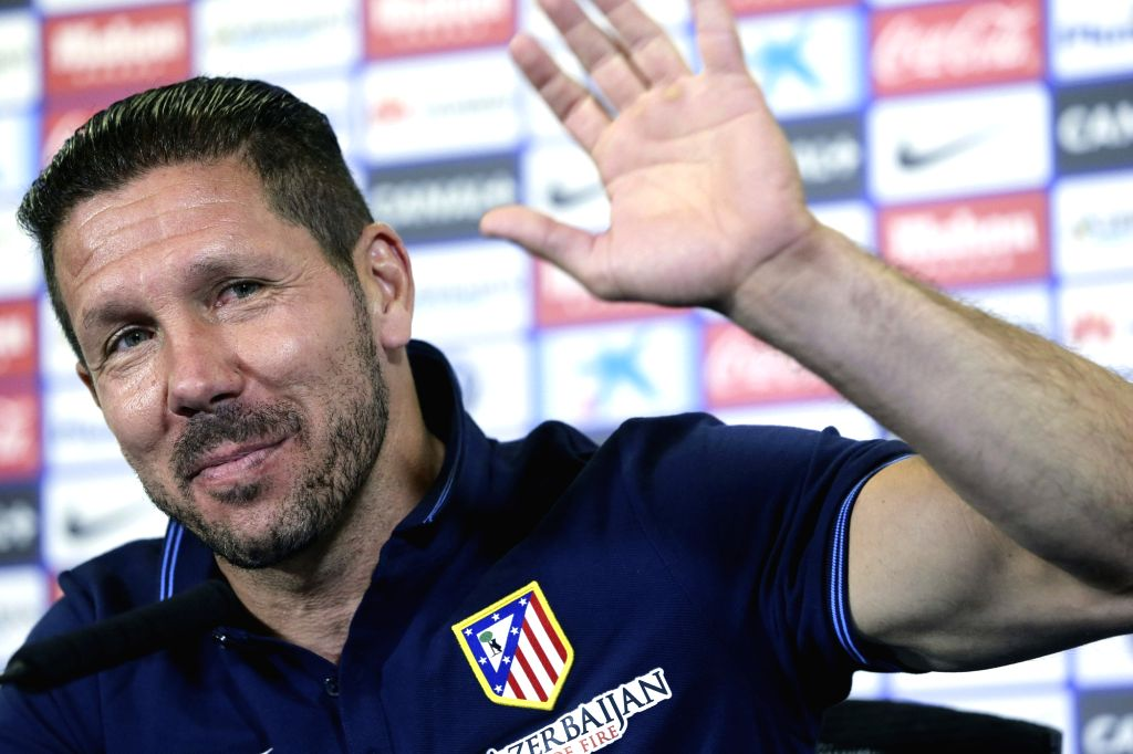 Madrid: Head coach of Atletico Madrid, Argentine Diego Simeone, waves to journalists during a press conference following a training session held at the Vicente Calderon stadium in Madrid, Spain, 16 May 2015. Atletico Madrid will face FC Barcelona in