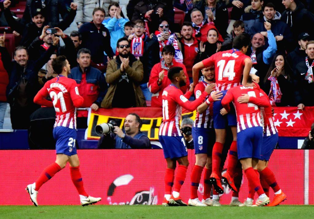 MADRID, Jan. 27, 2019 - Atletico Madrid's Antoine Griezmann (1st R) competes during a Spanish league match between Atletico Madrid and Getafe in Madrid, Spain, on Jan. 26, 2019. Atletico Madrid won ...