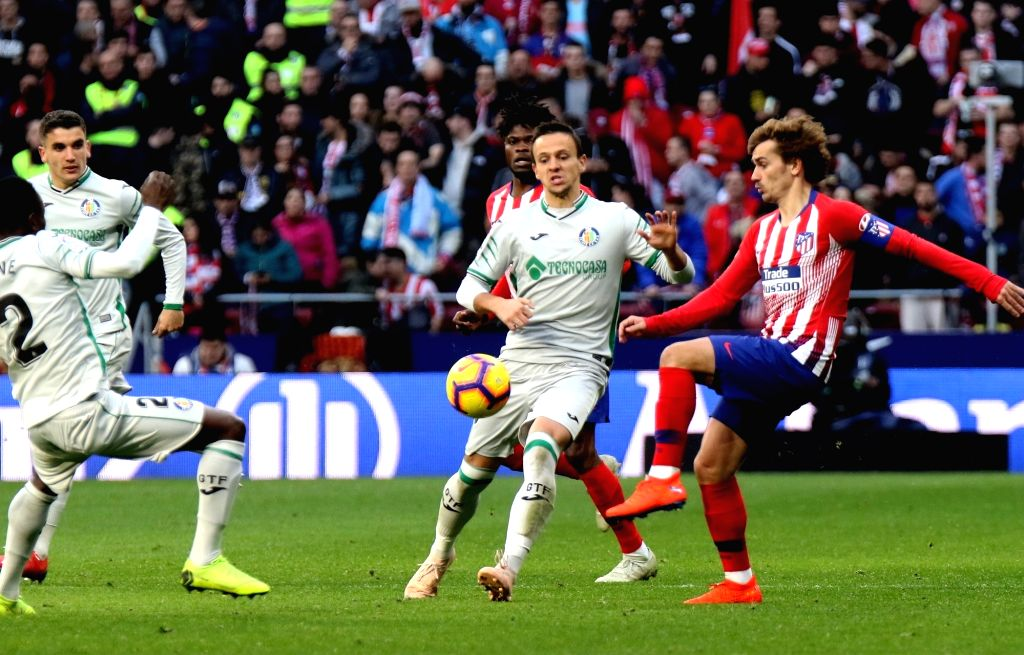 MADRID, Jan. 27, 2019 - Atletico Madrid's players celebrate a goal of their team during a Spanish league match between Atletico Madrid and Getafe in Madrid, Spain, on Jan. 26, 2019. Atletico Madrid ...