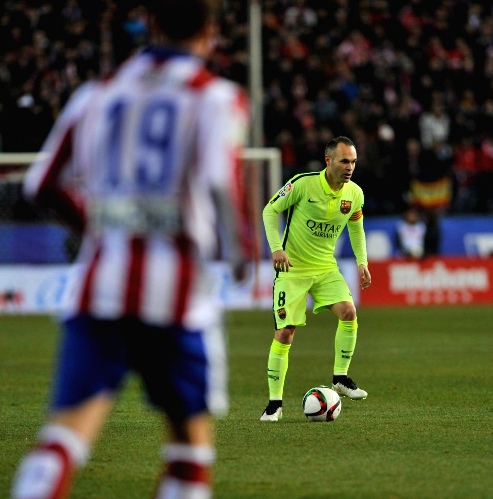 Barcelona's Iniesta reacts during the King's Cup quarter-final second leg match against Atletico Madrid at the Vicente Calderon Stadium in Madrid, Spain, Jan. 28, ..