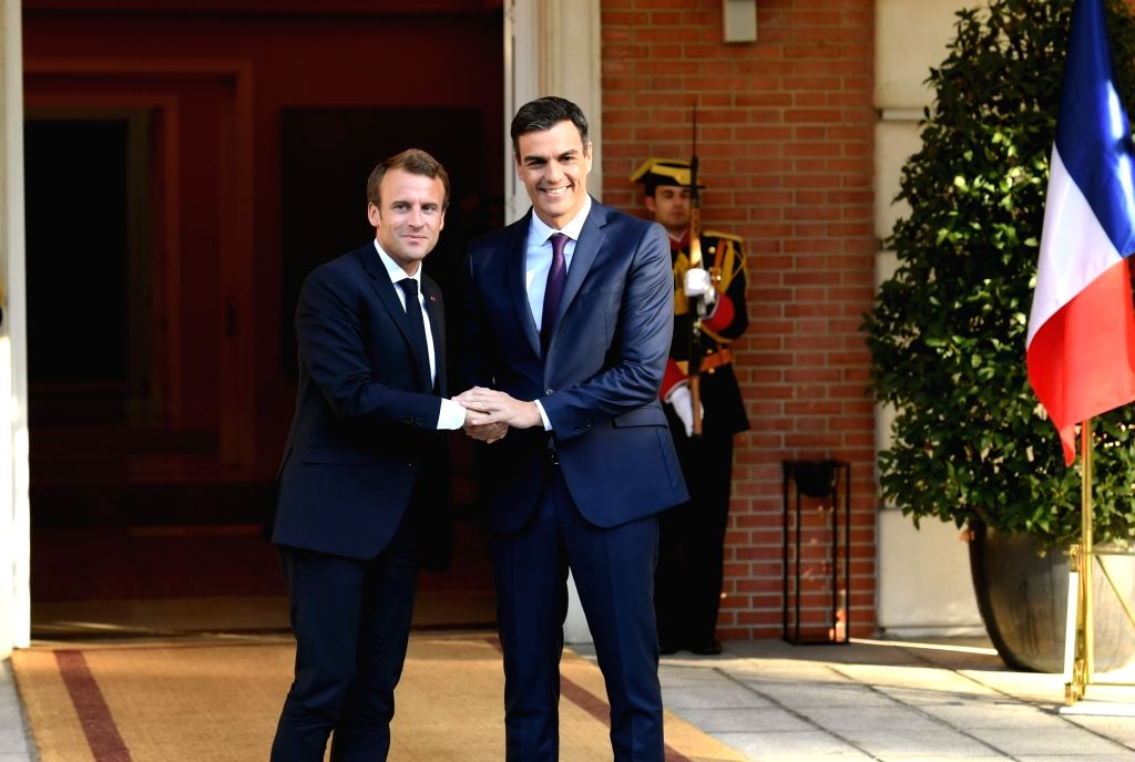 MADRID, July 27, 2018 - Spanish Prime Minister Pedro Sanchez (R) shakes hands with French President Emmanuel Macron in Madrid, Spain on July 26, 2018. - Pedro Sanchez