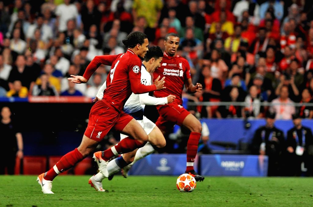 MADRID, June 2, 2019 - Hotspur's Son Heung-min (C) competes with Liverpool's Virgil Van Dijk (L) during the UEFA Champions League final match between two British teams Liverpool and Tottenham Hotspur ...