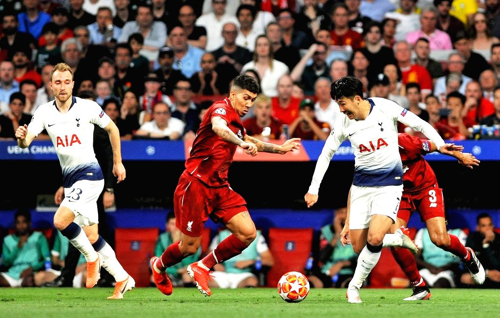 MADRID, June 2, 2019 - Hotspur's Son Heung-min (R) competes with Liverpool's Roberto Firmino (C) during the UEFA Champions League final match between two British teams Liverpool and Tottenham Hotspur ...