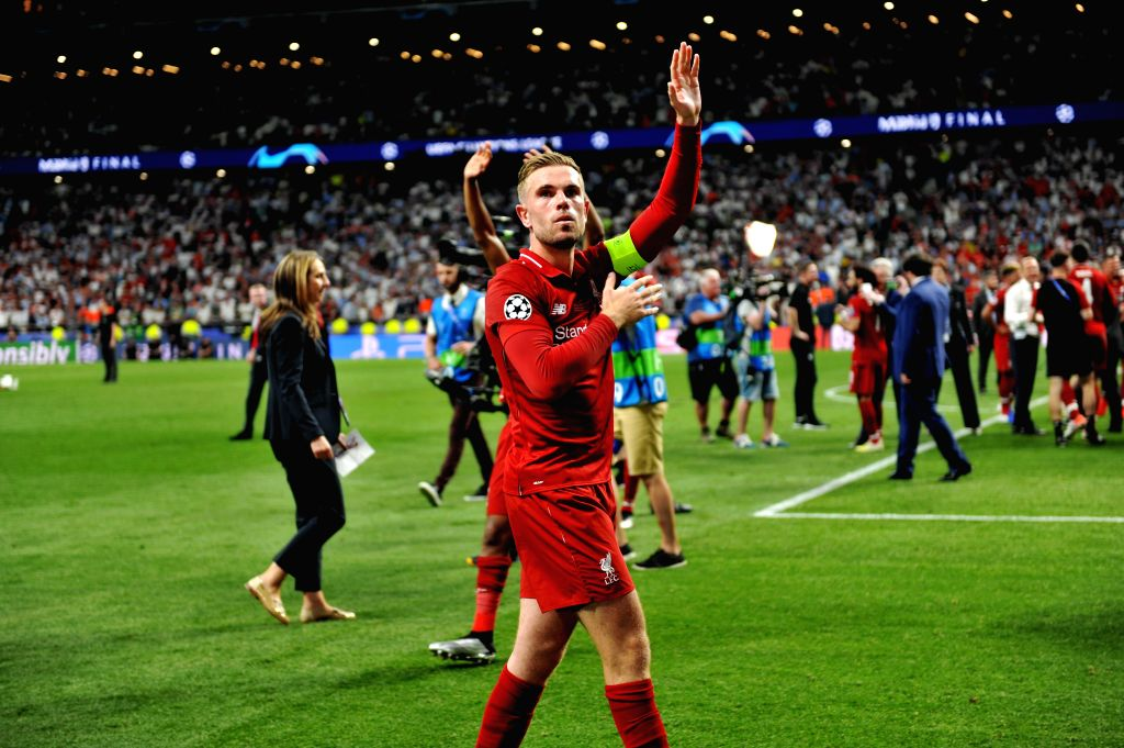 MADRID, June 2, 2019 - Liverpool's Jordan Henderson (front) greets the fans after the UEFA Champions League final match between two British teams Liverpool and Tottenham Hotspur in Madrid, Spain, on ...