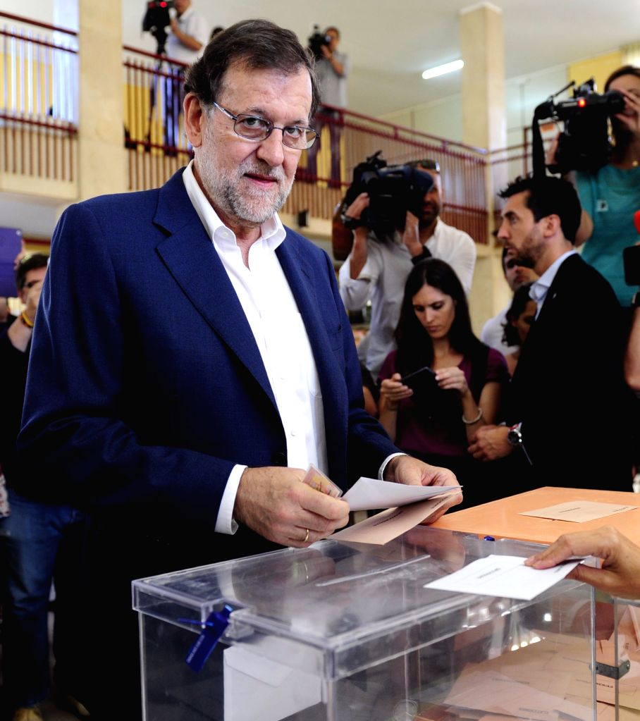 MADRID, June 26, 2016 - Mariano Rajoy (front), acting Spanish Prime Minister and the leader of the People's Party (PP), casts his vote at Bernadette School polling station in Madrid, Spain, on June ...