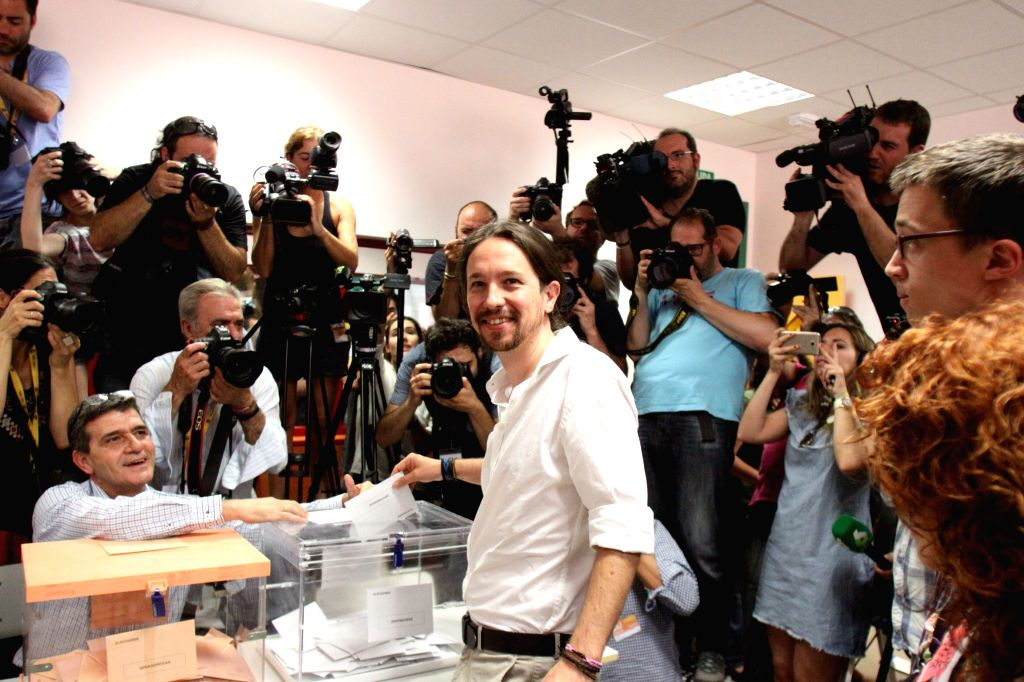 MADRID, June 26, 2016 - Podemos leader Pablo Iglesias (C) casts his vote at Tirso de Molina school in Vallecas near Madrid, Spain, on June 26, 2016. Voting began at 9 a.m. local time in the second ...