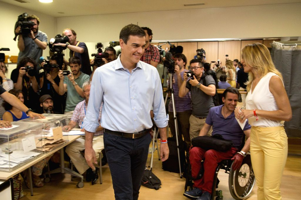 MADRID, June 26, 2016 - Socialist (PSOE) Leader Pedro Sanchez (C) leaves after casting his vote in Pozuelo de Alarcon near Madrid, Spain, on June 26, 2016. Voting began at 9 a.m. local time in the ...