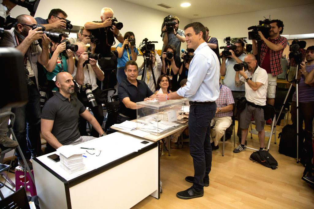 MADRID, June 26, 2016 - Socialist (PSOE) Leader Pedro Sanchez (C) casts his vote in Pozuelo de Alarcon near Madrid, Spain, on June 26, 2016. Voting began at 9 a.m. local time in the second general ...