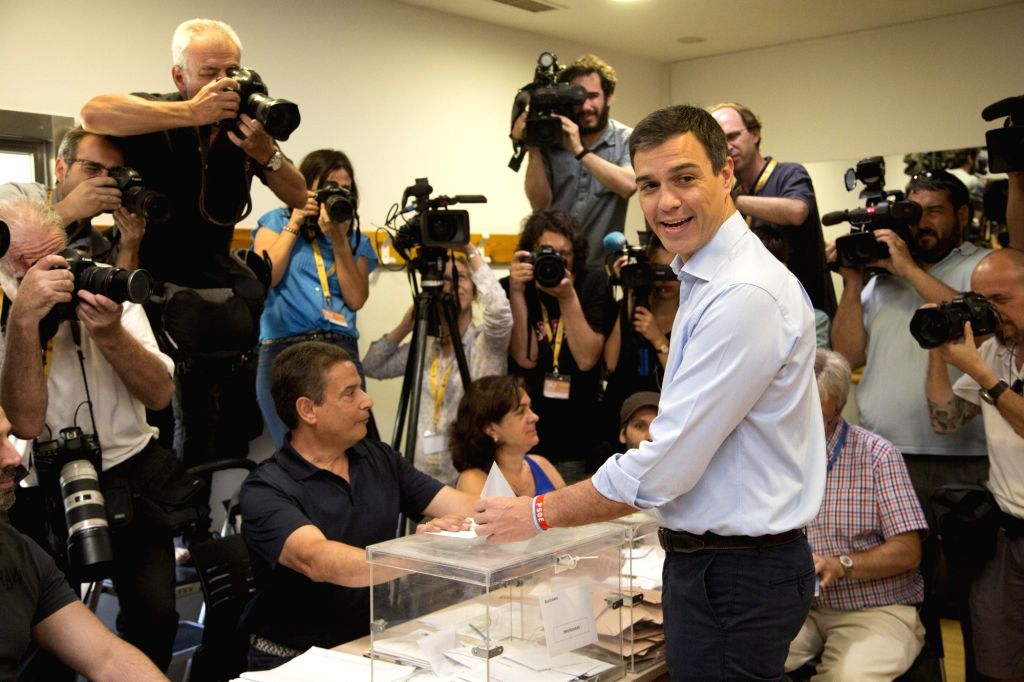MADRID, June 26, 2016 - Socialist (PSOE) Leader Pedro Sanchez (front R) casts his vote in Pozuelo de Alarcon near Madrid, Spain, on June 26, 2016. Voting began at 9 a.m. local time in the second ...