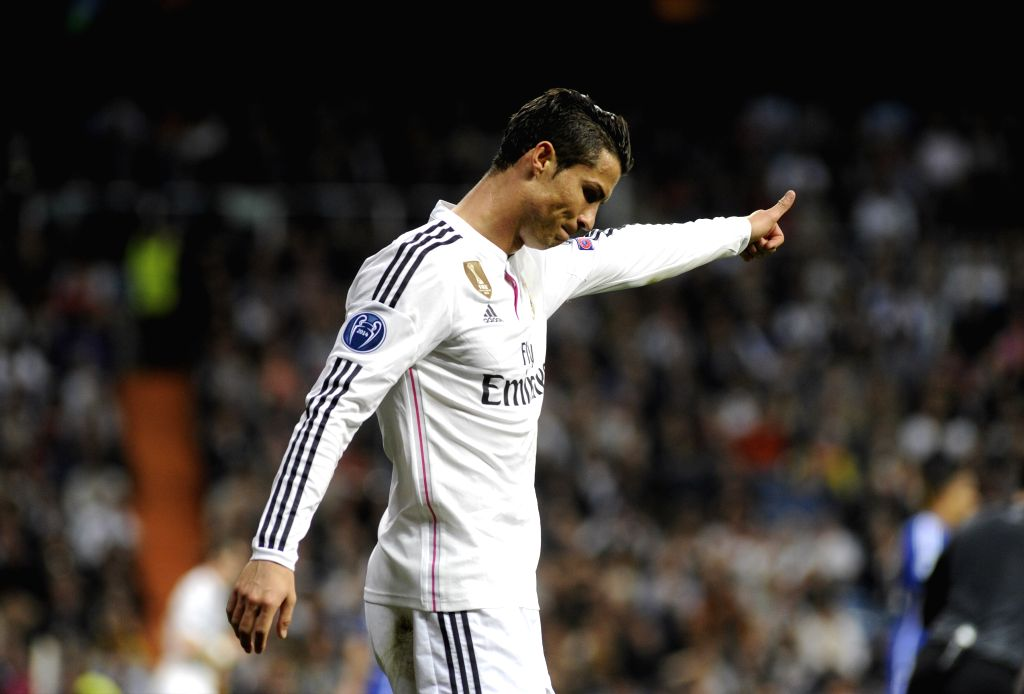 Real Madrid's Portuguese forward Cristiano Ronaldo celebrates his goal during the Champions League football match 2nd leg against Schalke 04 at Santiago Bernabeu ...