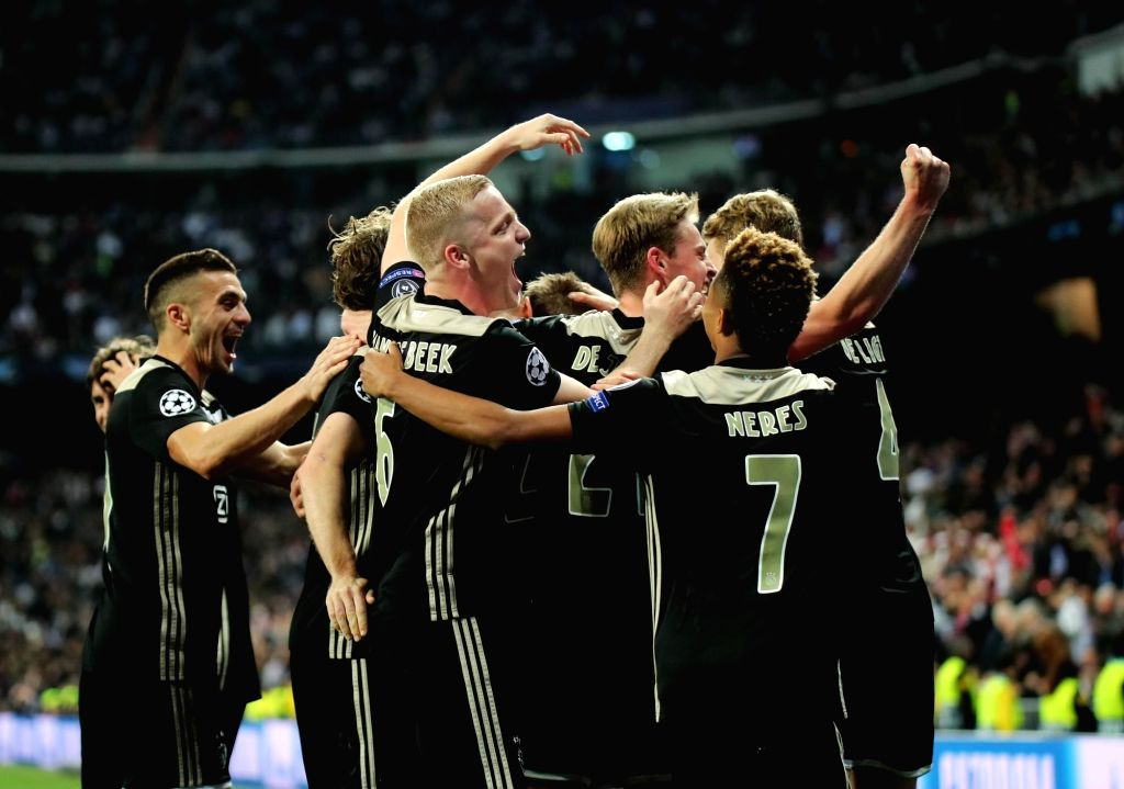 MADRID, March 6, 2019 (Xinhua) -- Ajax's players celebrate scoring during the UEFA Champions League round of 16 second leg soccer match between Real Madrid and Ajax in Madrid, Spain, on March 5, 2019. (Xinhua/Edward F. Peters/IANS)