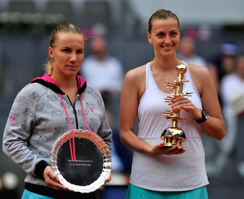 Petra Kvitova (R) of the Czech Republic poses with Svetlana Kuznetsova of Russia during the awarding ceremony after their final match at the WTA Madrid Open tennis ...
