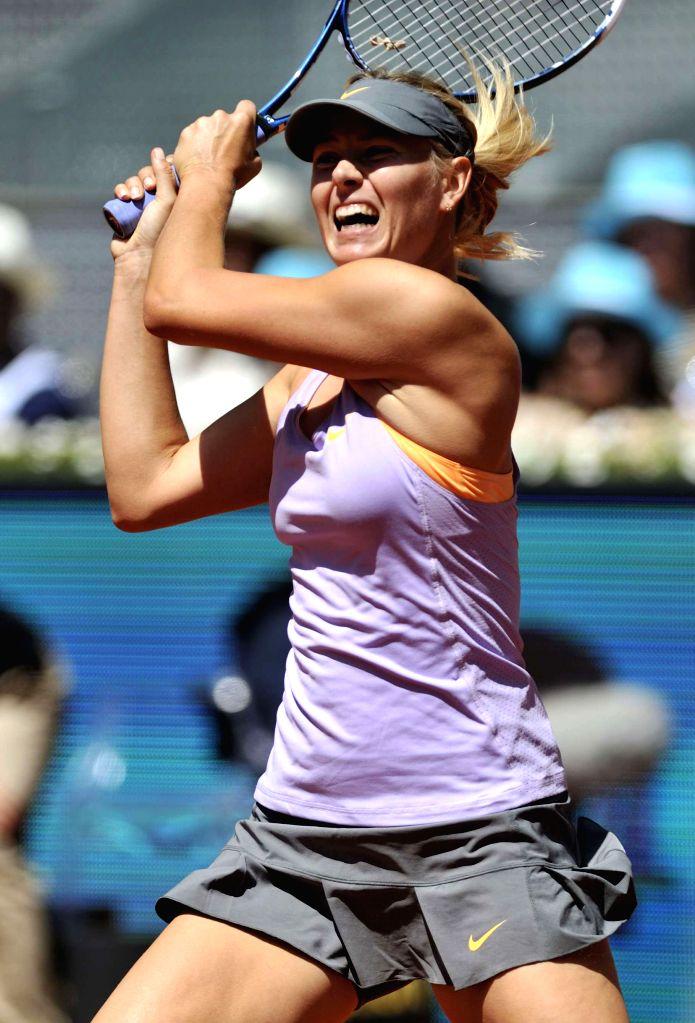 Maria Sharapova of Russia returns the ball during the women's singles first round match against Klara Koukalova of Czech at the WTA Mutua Madrid Open in Madrid, ...