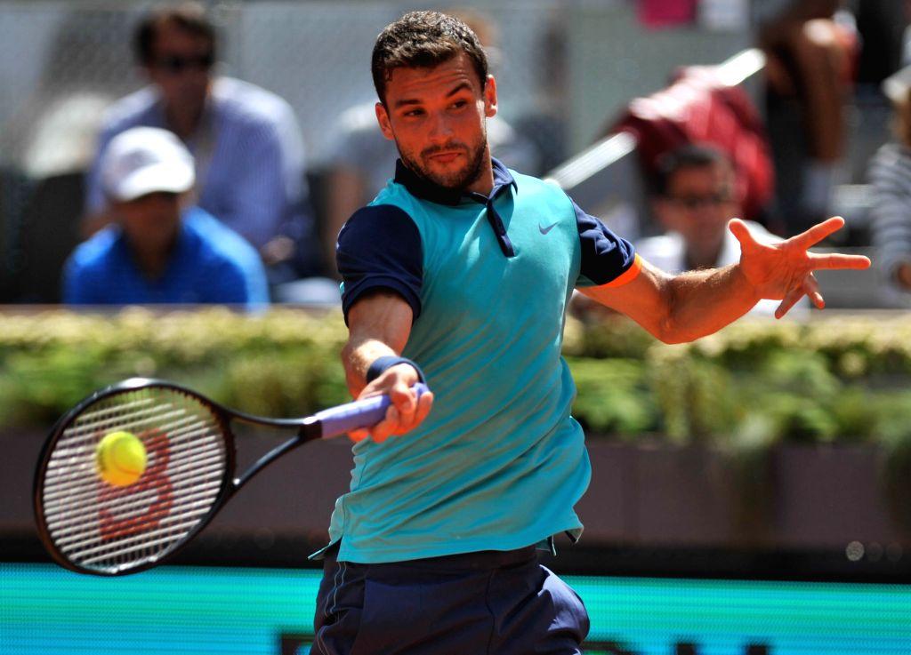 Grigor Dimitrov of Bulgaria returns the ball during the men's singles quarterfinal against Rafael Nadal of Spain at the Madrid Open tennis tournament in Madrid, Spain, ...