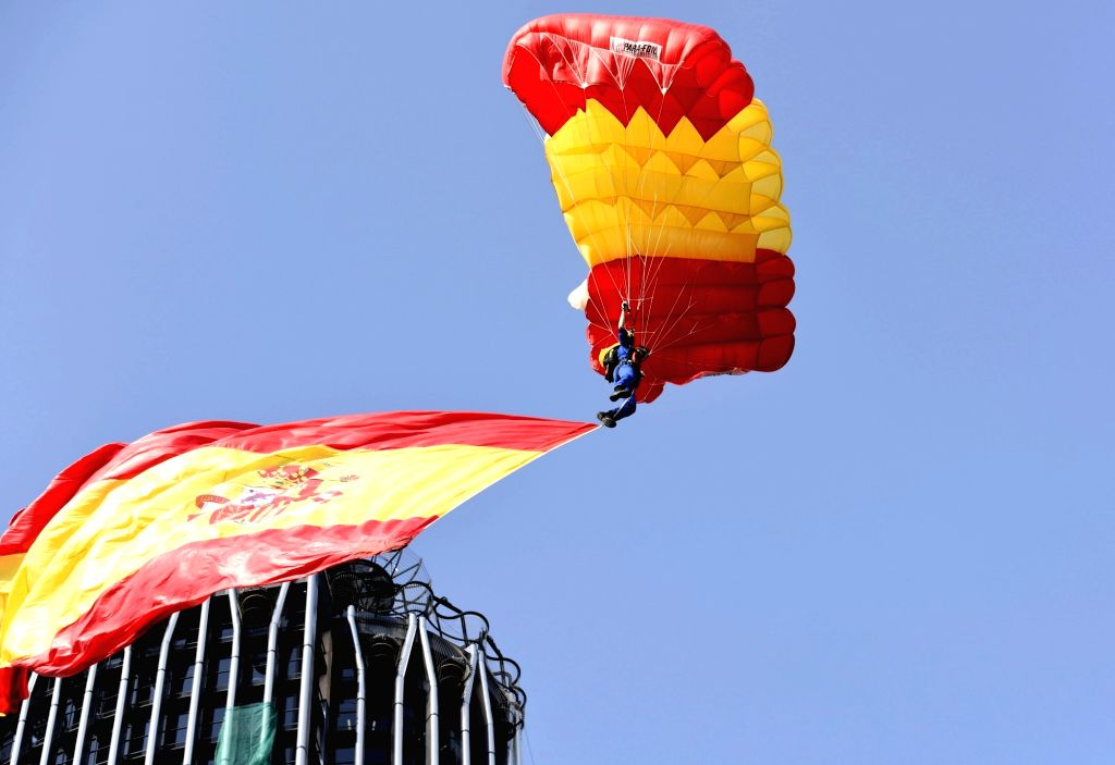 MADRID, Oct. 12 A paratrooper glides over Madrid with a national flag to celebrate the national day of Spain in Madrid, Spain, Oct. 12, 2017. Spain held a traditional parade to celebrate ...