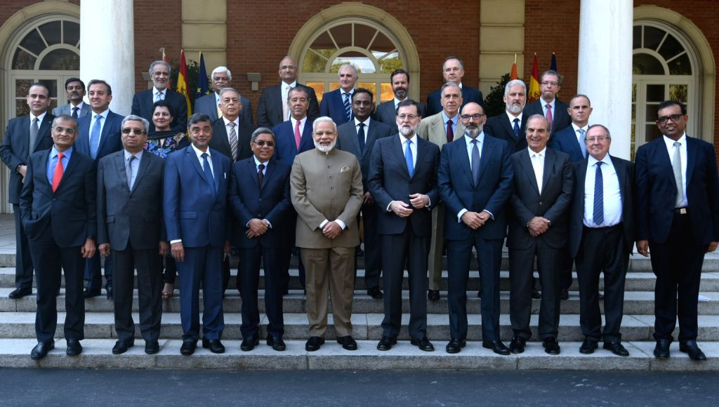 Madrid: Prime Minister Narendra Modi and Spanish President Mariano Rajoy with the members of India Spain CEOs Forum in Madrid, Spain on May 31, 2017. - Narendra Modi
