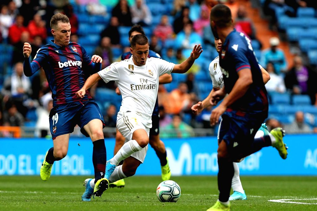 MADRID, Sept. 14, 2019 - Real Madrid's Eden Hazard (2nd L) competes during a Spanish league soccer match between Real Madrid and Levante in Madrid, Spain, Sept. 14, 2019.