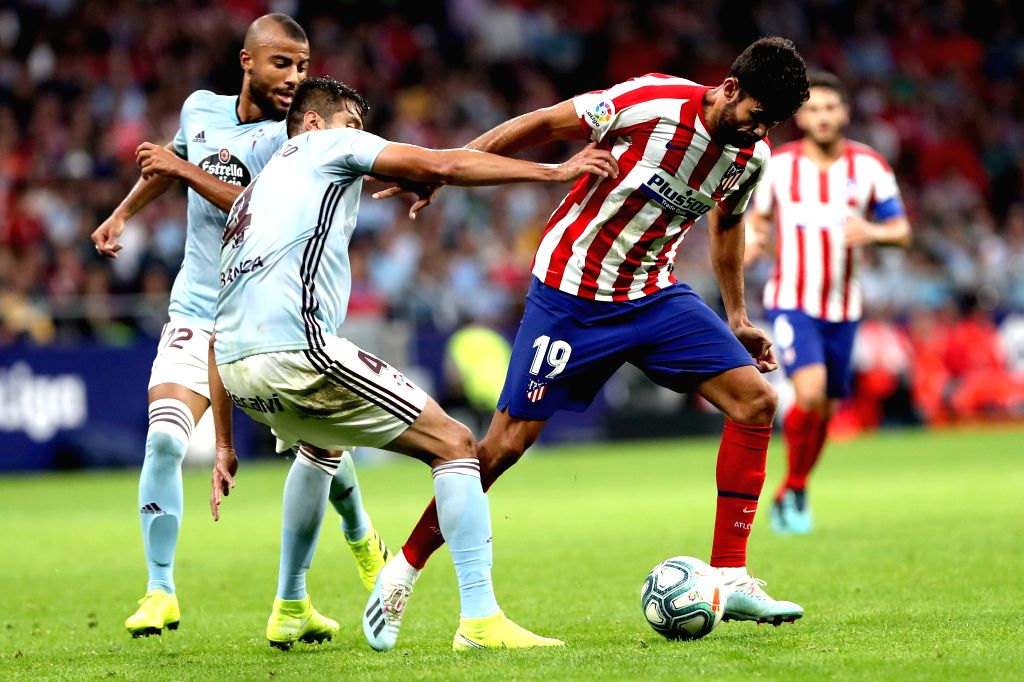 MADRID, Sept. 22, 2019 - Atletico de Madrid's Diego Costa (R) and Celta's Nestor Araujo (C) vie for the ball during a Spanish league soccer match between Atletico de Madrid and Celta in Madrid, ...