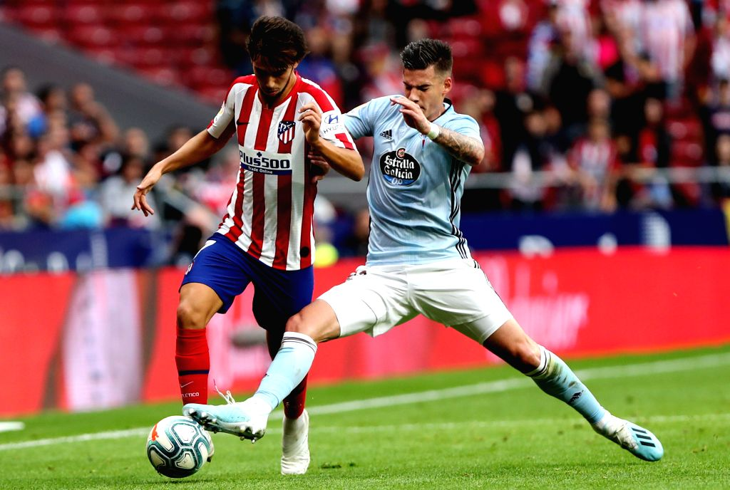 MADRID, Sept. 22, 2019 - Atletico de Madrid's Joao Felix (L) and Celta's Santi Mina vie for the ball during a Spanish league soccer match between Atletico de Madrid and Celta in Madrid, Spain, on ...