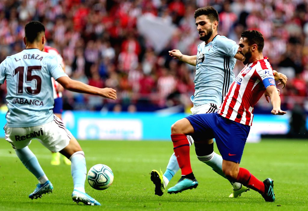 MADRID, Sept. 22, 2019 - Atletico de Madrid's Koke Resurreccion (R) competes during a Spanish league soccer match between Atletico de Madrid and Celta in Madrid, Spain, on Sept. 21, 2019. (Xinhua/Ai ...