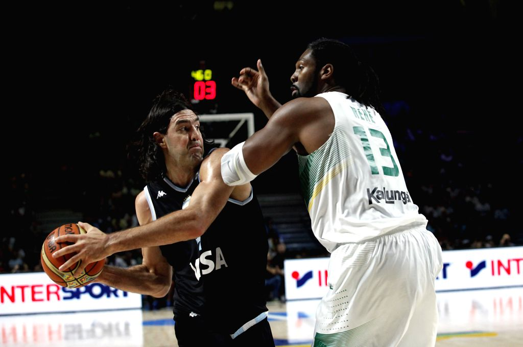 Luis Scola (L) of Argentina holds the ball during the Round of 16 match against Brazil at the 2014 FIBA Basketball World Cup in Madrid, Spain, on Sept. 7, 2014. ...