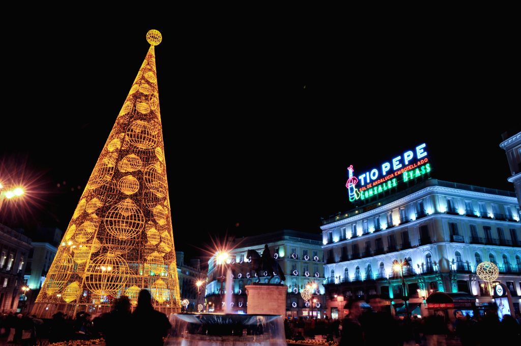 Madrid (Spain): Famous landmark Puerta del Sol square is illuminated with lights for Christmas in Madrid, Spain on Dec. 11, 2014. It is estimated that Madrid would invest 1.7 millions euros in ...