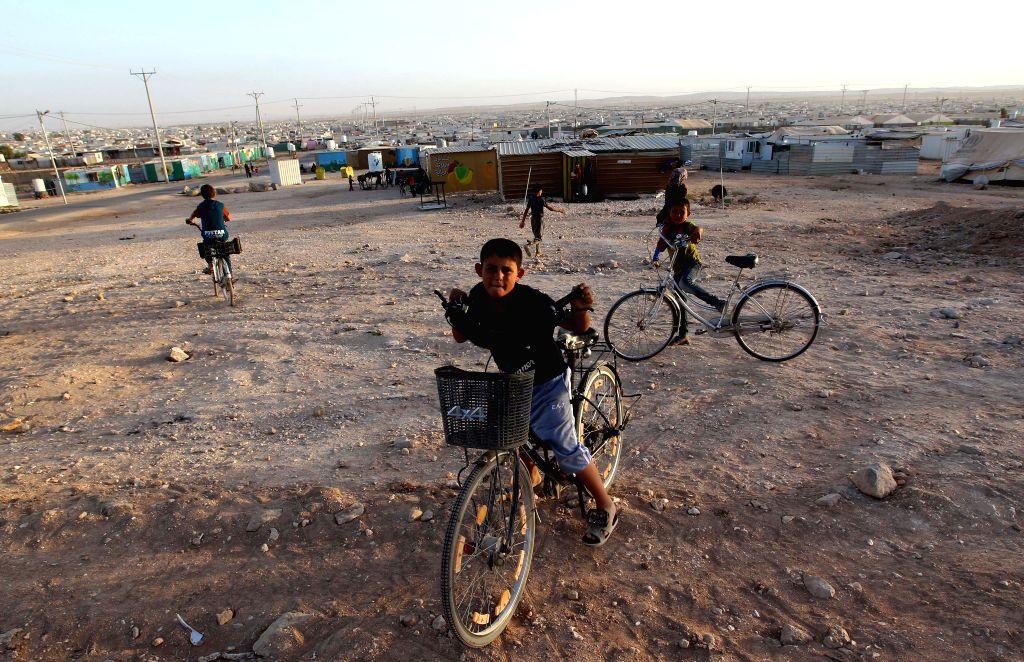 MAFRAQ, June 20, 2017 - Syrian refugee children are seen at Zaatari Syrian refugee camp near the city of Mafraq, Jordan, on June 19, 2017.
