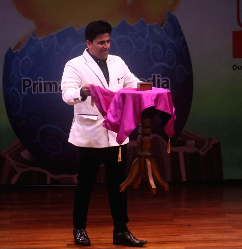 """Magician Tushar Kumar's magic show underway during an interactive session on """"Effective Learning"""" at British Council in New Delhi on July 21, 2018. - Tushar Kumar"""