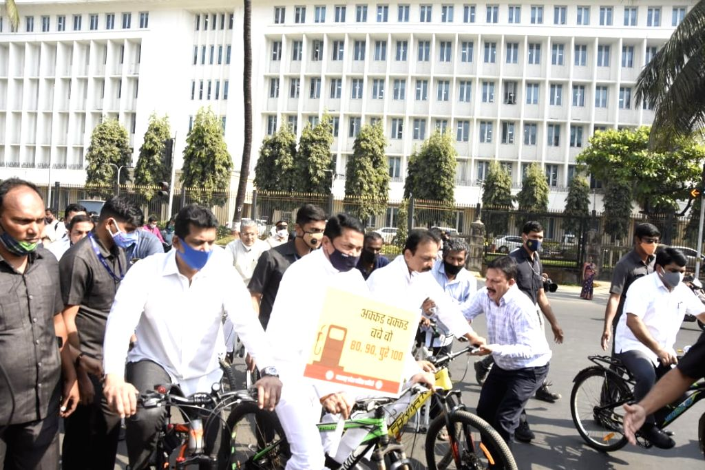 Maha Cong ministers protest high fuel prices on bicycles