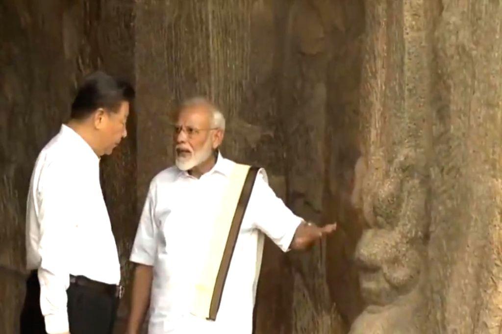 Mahabalipuram: Prime Minister Narendra Modi and Chinese President Xi Jinping during their visit to Varaha Cave Temple in Mahabalipuram, Tamil Nadu on Oct 11, 2019. (Photo: IANS/PIB) - Narendra Modi
