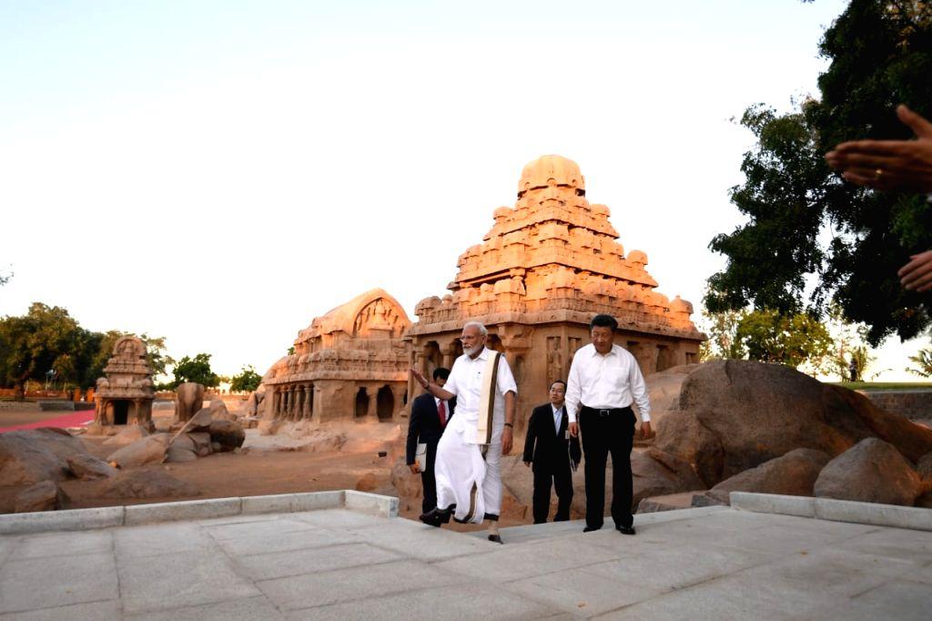 Mahabalipuram: Prime Minister Narendra Modi and Chinese President Xi Jinping during their visit to Pancha Rathas complex in Mahabalipuram, Tamil Nadu on Oct 11, 2019. (Photo: IANS/MEA) - Narendra Modi