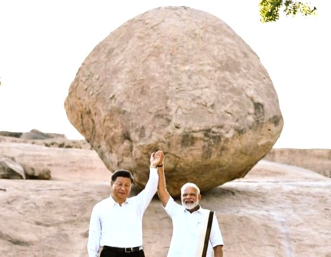 Mahabalipuram: Prime Minister Narendra Modi and Chinese President Xi Jinping during their visit to Krishna's butterball - a gigantic granite boulder sitting firmly on the slope of a hillock - in Mahabalipuram, Tamil Nadu on Oct 11, 2019. (Photo: IANS - Narendra Modi