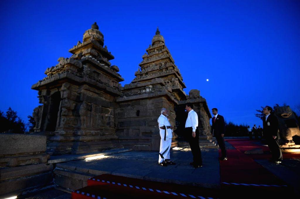 Mahabalipuram: Prime Minister Narendra Modi and Chinese President Xi Jinping during their visit to Shore Temple in Mahabalipuram, Tamil Nadu on Oct 11, 2019. (Photo: IANS/MEA) - Narendra Modi