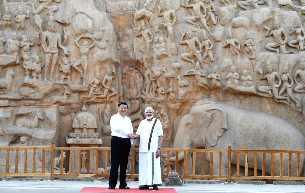 Mahabalipuram: Prime Minister Narendra Modi and Chinese President Xi Jinping during their visit to Pancha Rathas complex in Mahabalipuram, Tamil Nadu on Oct 11, 2019. (Photo: IANS/PIB) - Narendra Modi
