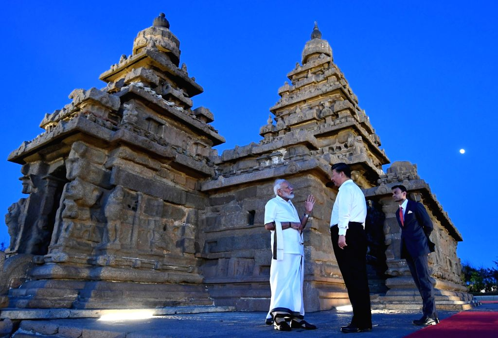Mahabalipuram: Prime Minister Narendra Modi and Chinese President Xi Jinping during their visit to Shore Temple in Mahabalipuram, Tamil Nadu on Oct 11, 2019. (Photo: IANS/PIB) - Narendra Modi
