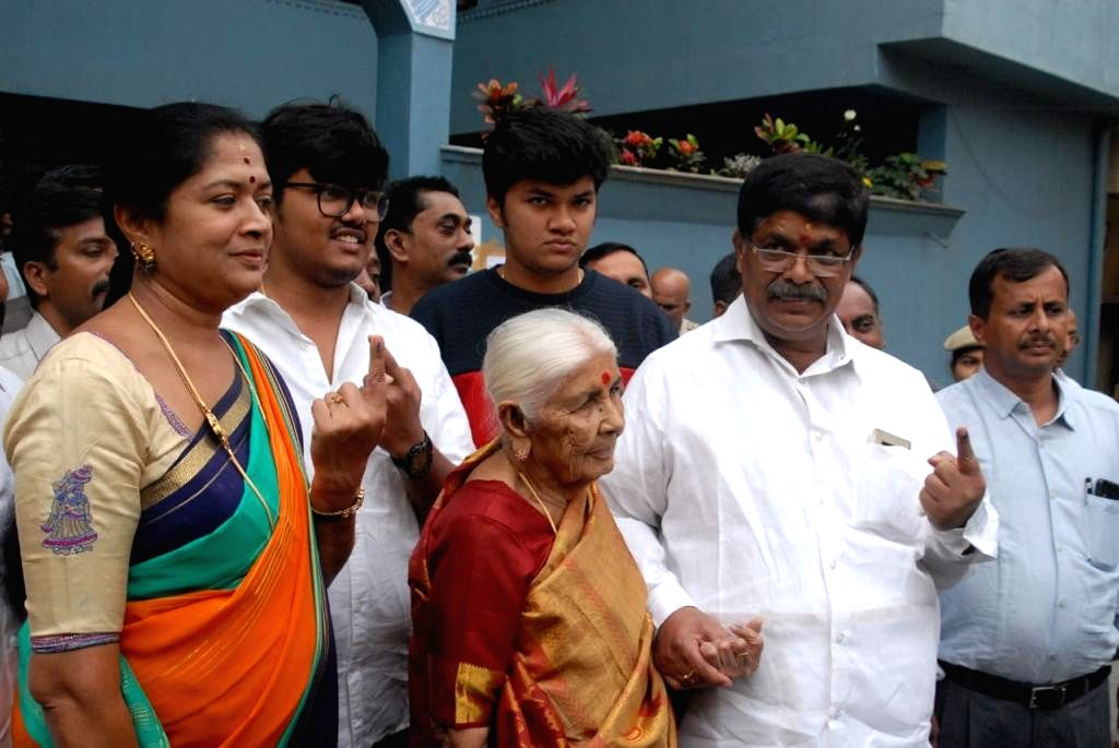 Mahalakshmi Layout BJP Candidate Gopalaiah and his family members showing inked fingers after casting their vote for the assembly Bye Election at Mahalakshmi Layout constituency in ...