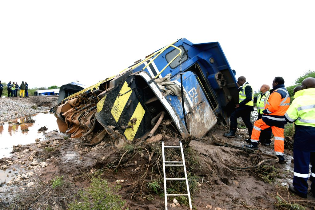 MAHALAPYE (BOTSWANA), Dec. 10, 2019 Photo taken on Dec. 10, 2019 shows a derailed passenger train near Mahalapye village in Botswana. A passenger train derailed in the early hours of ...