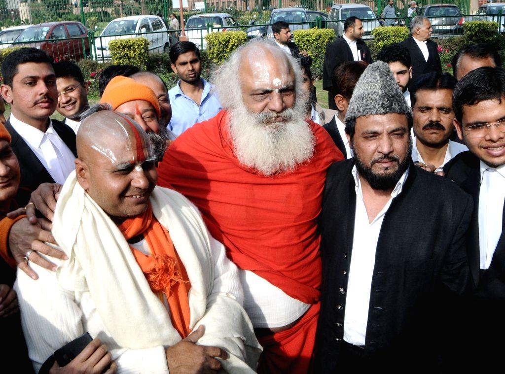 Mahant Ramdas, Mahant Dharam Das and self-proclaimed descendant of Mughal emperor Bahadur Shah Zafar, Prince Yakub Habeebuddin Tucy outside the Supreme Court after a hearing on the Babri ... - Bahadur Shah Zafar