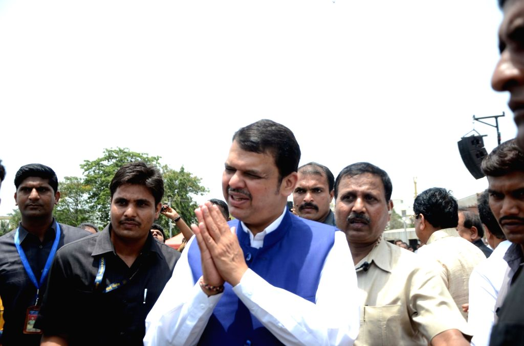 Maharashra Chief Minister Devendra Fadnavis at the flagging off ceremony of Electric Vehicles at the launch of a service where all-electric city car will be available on rent for residents ... - Devendra Fadnavis