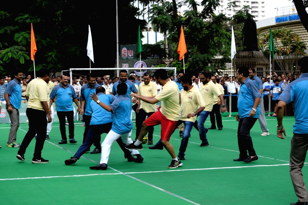 Maharashtra Assembly MLAs in action during a football match at Assembly ground in Mumbai on Aug 10, 2017.