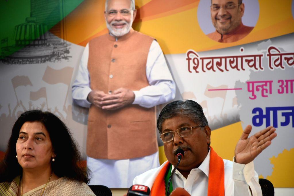Maharashtra BJP President Chandrakant Patil addresses a press conference in Mumbai, on Sep 24, 2019. - Chandrakant Patil
