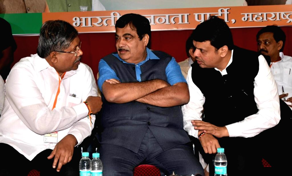 Maharashtra Chief Minister and BJP leader Devendra Fadnavis and Union Minister for Road Transport & Highways and Shipping Nitin Gadkari during a party working committee meeting in Mumbai ...