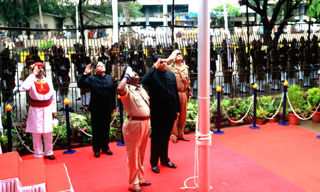 Maharashtra Chief Minister Devendra Fadnavis salutes the national flag on the occasion of 69th ``Independence Day`` celebration in Mumbai, on Aug 15, 2015.