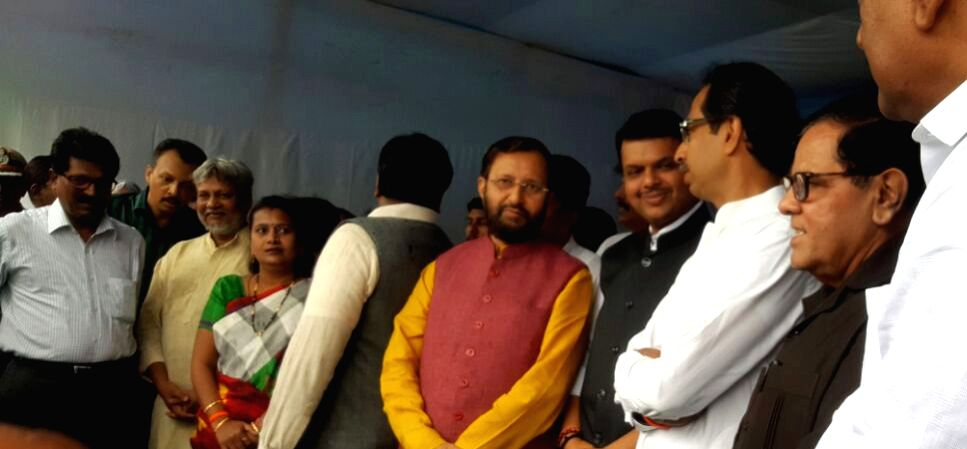 Maharashtra Chief Minister Devendra Fadnavis, Union Environment Minister Prakash Javadekar and Shiv Sena chief Uddhav Thackeray during the mega-afforestation drive to plant two crore sapling ... - Devendra Fadnavis